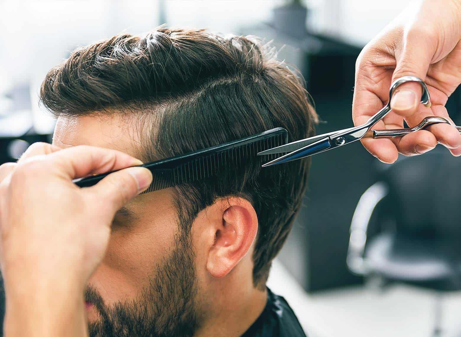 customer getting scissor over comb haircut