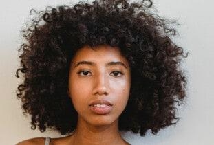 woman with curly medium length hair