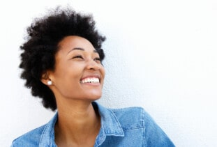happy woman with natural hair
