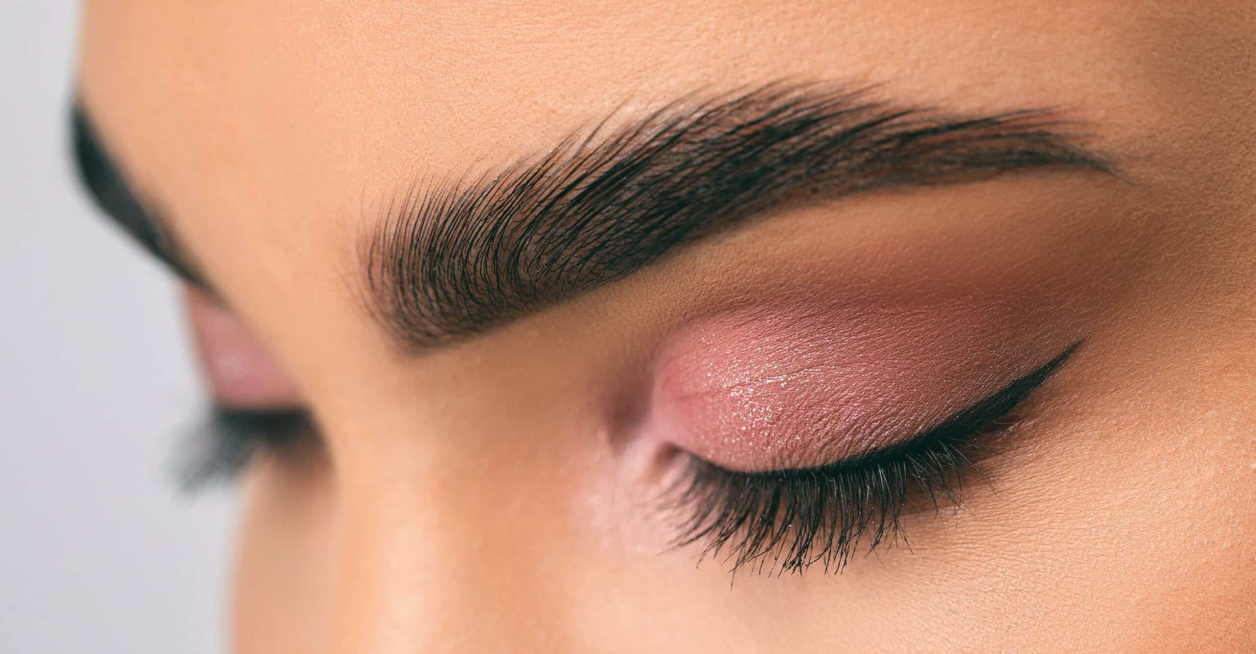 person with shaped brows and eye makeup