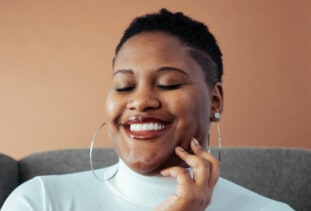 smiling woman with short natural hair